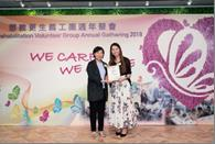 Ms. NG Sau-wai, Assistant Commissioner (Rehabilitation) and the recipient of the Most Devoted Volunteer Award, Ms. WONG Yik-tung, Krystal