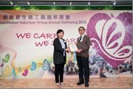 Ms. NG Sau-wai, Assistant Commissioner (Rehabilitation) and the recipient of the Community Education Ambassador Award, Mr. LAU Chun-ming