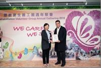 Ms. NG Sau-wai, Assistant Commissioner (Rehabilitation) and the recipient of the Most Devoted New Member Award, Mr. CHAN Pek-ho