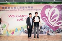 Ms. NG Sau-wai, Assistant Commissioner (Rehabilitation) and the recipient of the Long Service Award, Dr. LAI Wing-fu